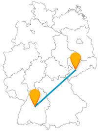 Stellen Sie mit der Fernbusreise zwischen Chemnitz und Stuttgart eine kleine Burg einer großen Autowelt gegenüber.