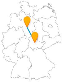 Nach der Reise im Fernbus zwischen Erfurt und Hannover finden Sie eine große Glocke und eine bewohnte Brücke.