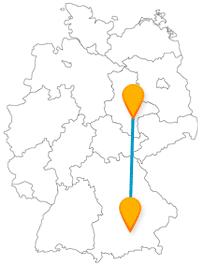 Viele Türme oder auch viele Menschen begegnen Sie auf Ihrer Reise im Fernbus zwischen Halle und München.