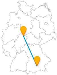 Entdecken Sie auf der Reise mit dem Fernbus zwischen Kassel und München komische Kunst und hören sich ein Glockenspiel an.