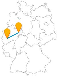 Vergleichen Sie mit dem Fernbus zwischen Köln und Paderborn zwei historisch anmutende Dome.